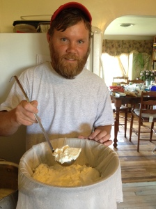 Making goat cheese! Scooping the curds in to the cheese cloth to drain the whey.